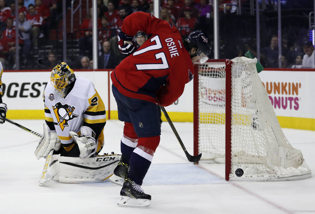 Washington Capitals right wing T.J. Oshie (77) misses a clean shot with Pittsburgh Penguins goalie Marc-Andre Fleury at left, during the second period of Game 7 in an NHL hockey Stanley Cup Easter ...