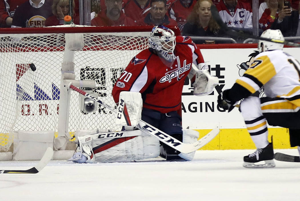 Pittsburgh Penguins right wing Bryan Rust (17) scores a goal past Washington Capitals goalie Braden Holtby (70) during the second period of Game 7 in an NHL hockey Stanley Cup Eastern Conference s ...