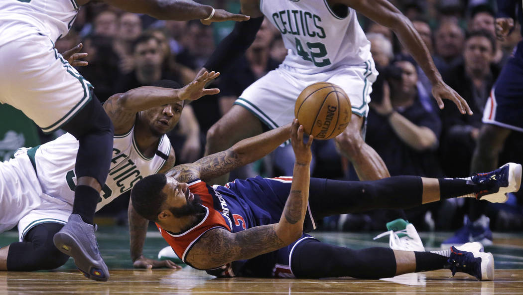 Washington Wizards forward Markieff Morris (5) looks to pass as he is surrounded by Boston Celtics players during the second quarter of Game 5 of an NBA basketball second-round playoff series, in  ...