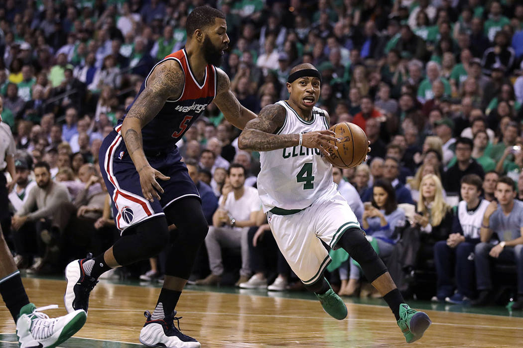 Boston Celtics guard Isaiah Thomas (4) drives to the basket past Washington Wizards forward Markieff Morris (5) during the second quarter of Game 5 of an NBA basketball second-round playoff series ...