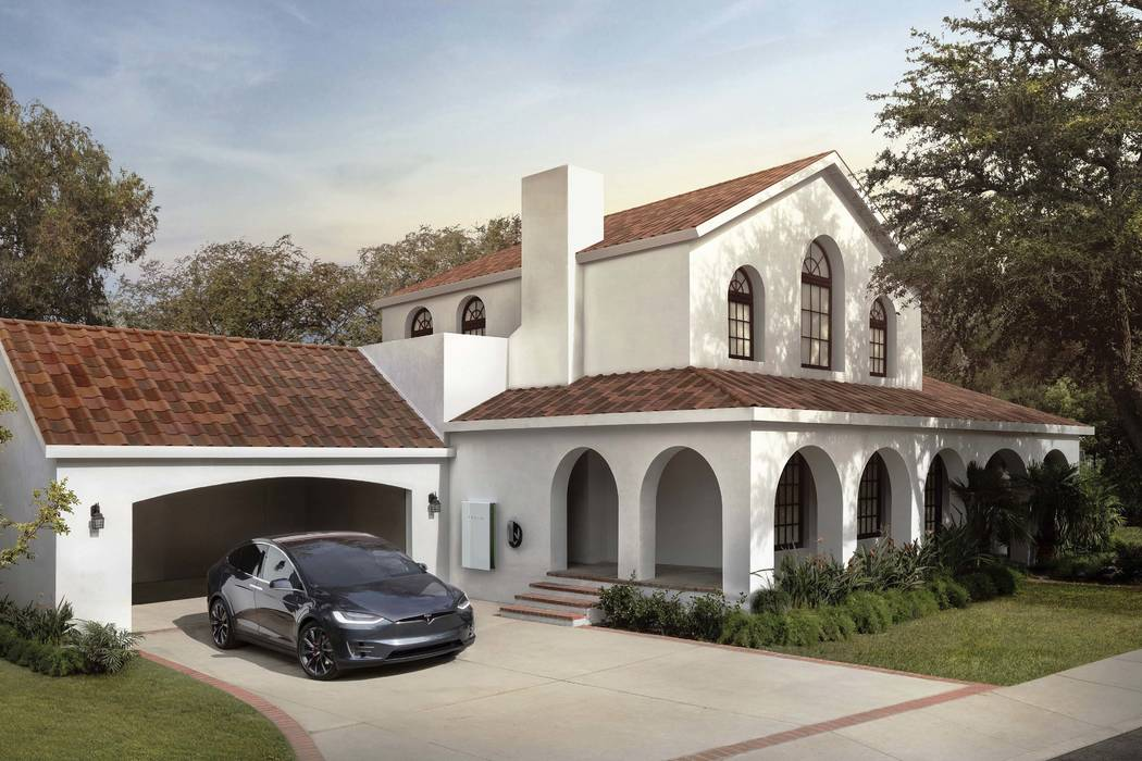 A house with Tesla's new terracotta solar roof tiles. As of Wednesday, May 10, 2017, customers worldwide could order a solar roof on Tesla's website. (Tesla via AP)