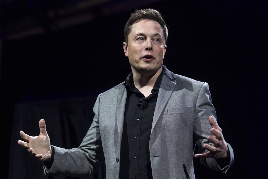 In this April 30, 2015, file photo, Tesla Motors CEO Elon Musk unveils the company's newest products, in Hawthorne, Calif. Electric car maker Tesla has added another product to its lineup: Solar r ...