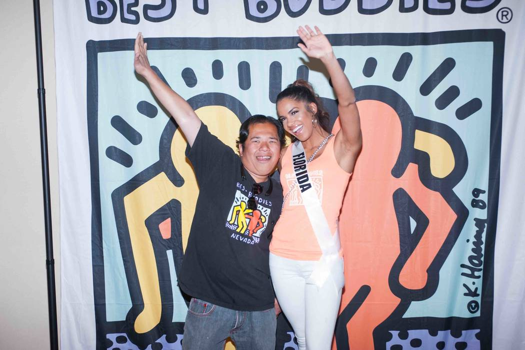 Miss Florida Linette De Los Santos stands for a photo with a new friend while working with Best Buddies International at Mandalay Bay on Sunday, May 7, 2017, in Las Vegas. (Miss Universe Organization)