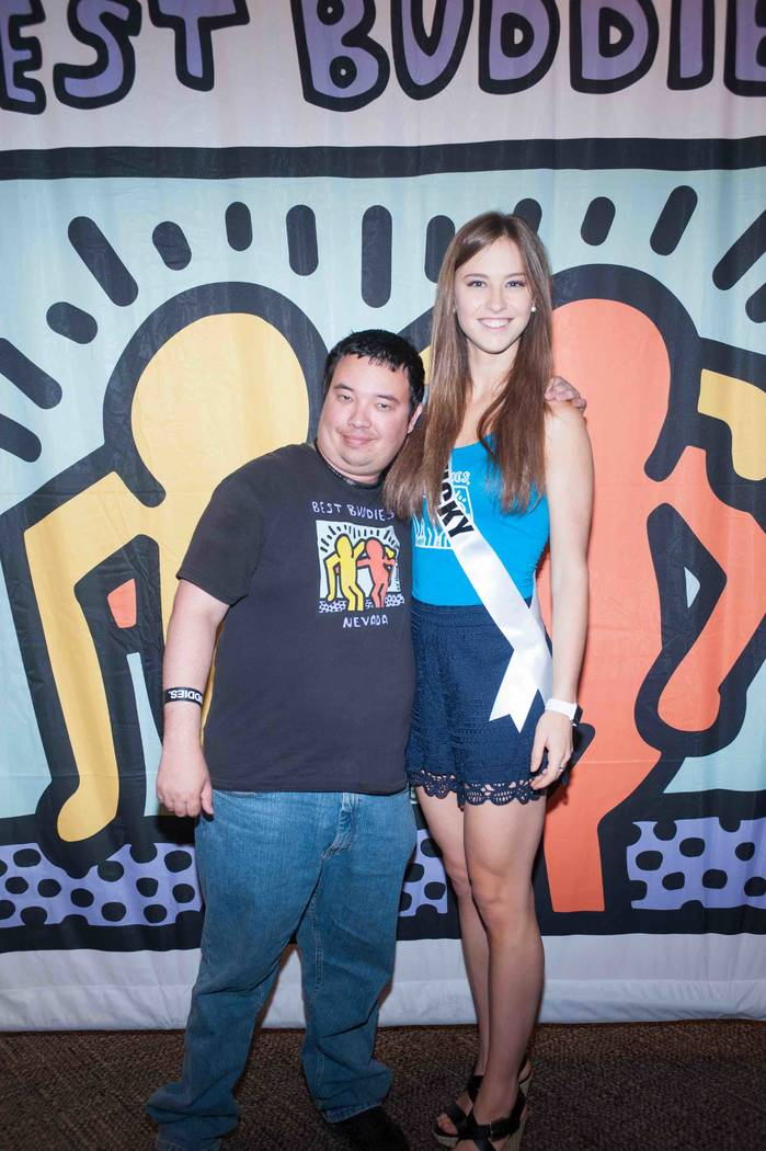 Miss Kentucky Madelynne Myers stands with a new friend while working with Best Buddies International at Mandalay Bay on Sunday, May 7, 2017, in Las Vegas. (Miss Universe Organization)