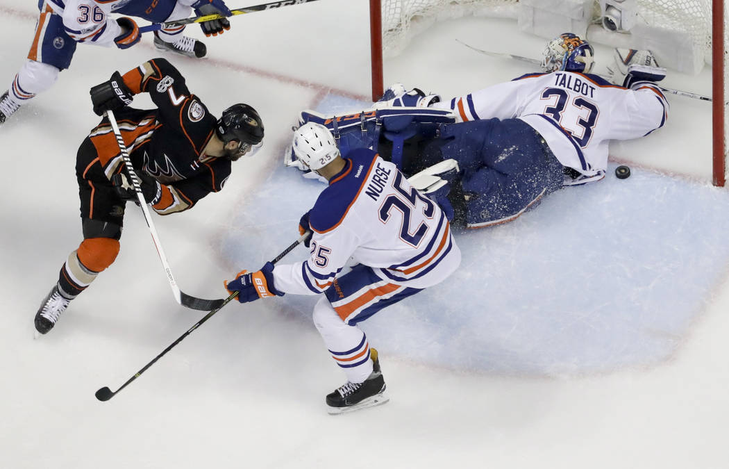Anaheim Ducks center Andrew Cogliano, left, scores past Edmonton Oilers goalie Cam Talbot, right, and Oilers' Darnell Nurse during the second period in Game 7 of a second-round NHL hockey Stanley  ...