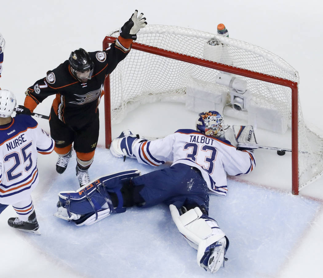 Anaheim Ducks center Andrew Cogliano, left, celebrates after scoring past Edmonton Oilers goalie Cam Talbot during the second period in Game 7 of a second-round NHL hockey Stanley Cup playoff seri ...