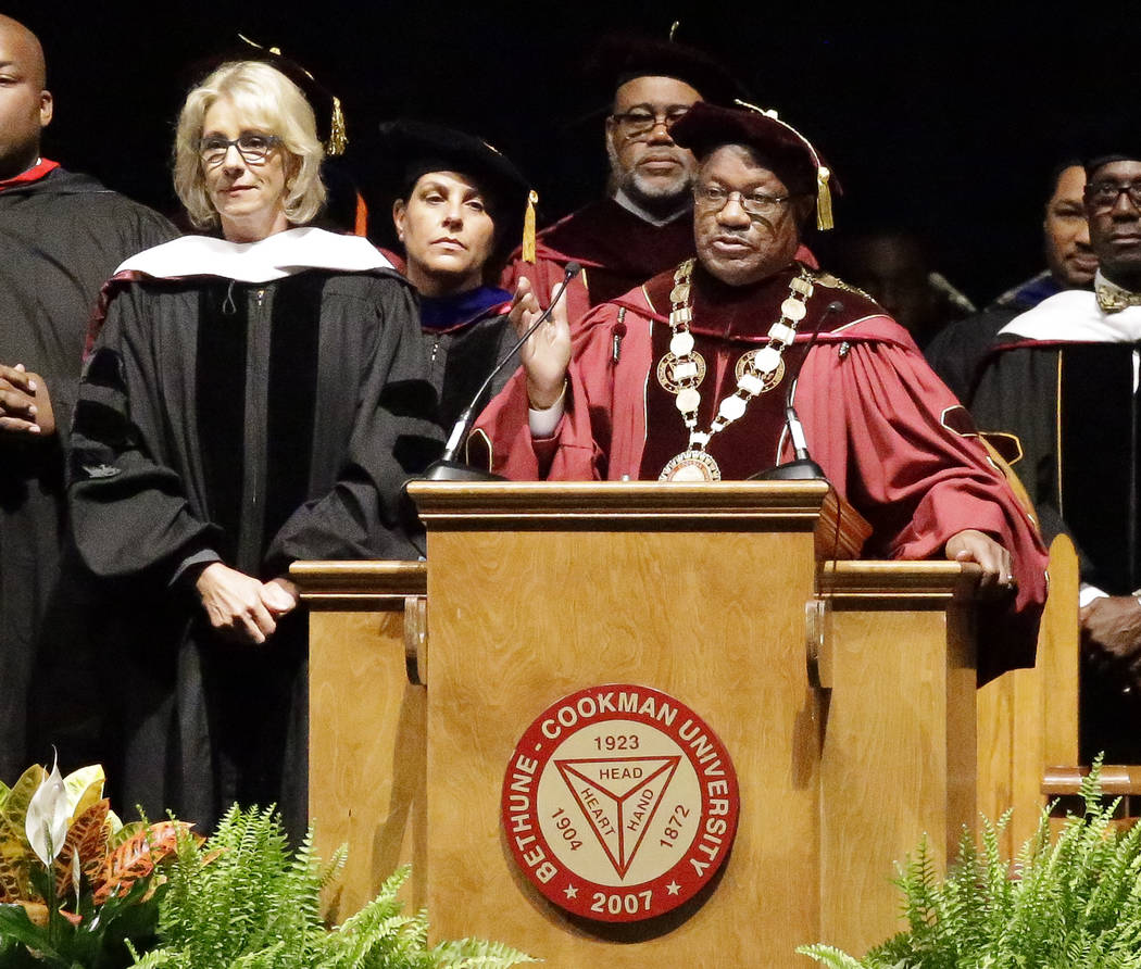 Bethune-Cookman University president Edison Jackson, right, appeals to protesters disrupting Education Secretary Betsy DeVos' speech during commencement exercises, Wednesday, May 10, 2017, in Dayt ...