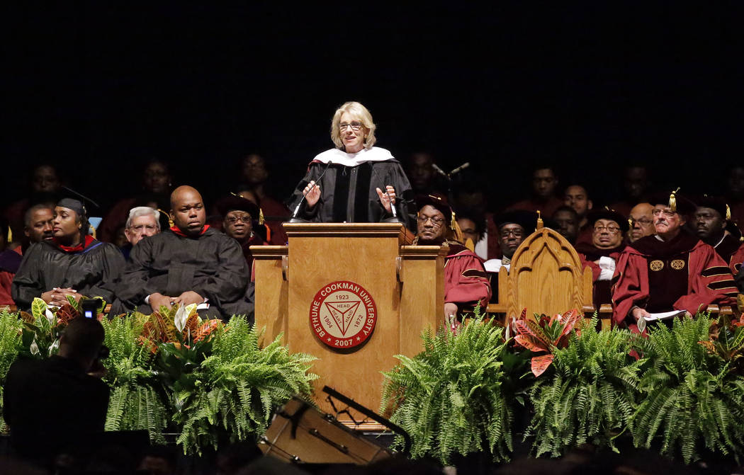 Education Secretary Betsy DeVos delivers a commencement address to graduates at Bethune-Cookman University, Wednesday, May 10, 2017, in Daytona Beach, Fla. (AP Photo/John Raoux)
