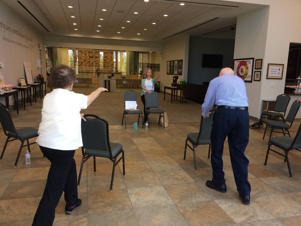 Both caregivers and those afflicted with Parkinson's Disease take part in a class led by Pamela Lappen, certified instructor, April 6, 2017 at Desert Spring United Methodist Church in Summerlin. T ...