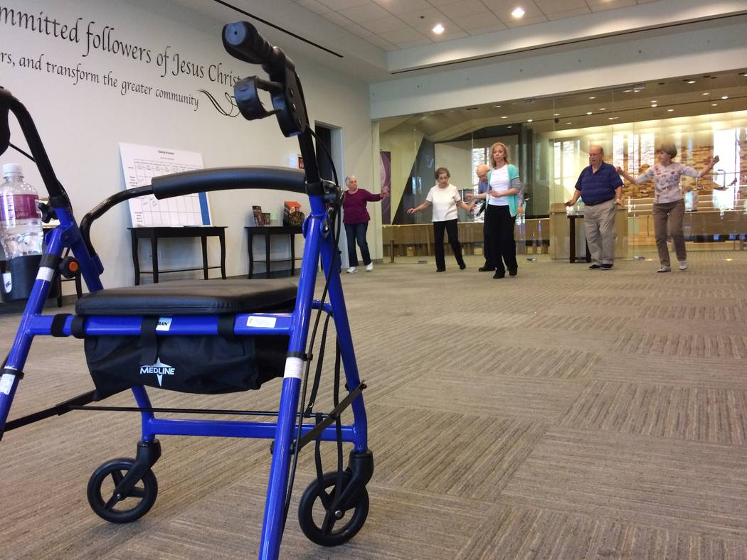 A walker sits unused as chair dancing takes place April 6, 2017, at Desert Spring United Methodist Church. 120 N. Pavilion Center Drive. The class, Dancing With Parkinson's, seeks to make a brai ...