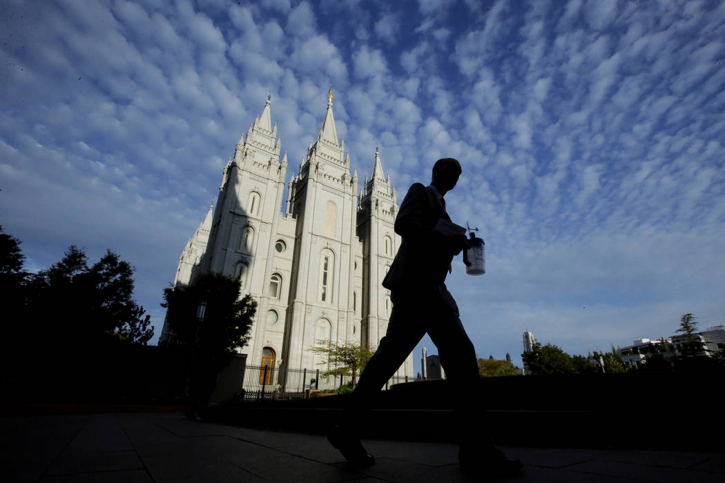 A man walks past the Salt Lake Temple, a temple of The Church of Jesus Christ of Latter-day Saints, at Temple Square, Wednesday, Sept. 14, 2016, in Salt Lake City. (Rick Bowmer/AP)