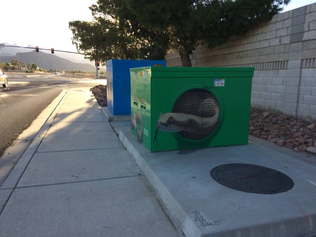 The utility box at Craig Road and Durango Drive, seen May 1, 2017,  uses Trompe l'oeil (French for 'trick of the eye') to make it look like an iguana is coming out of the box. (Jan Hogan/View)