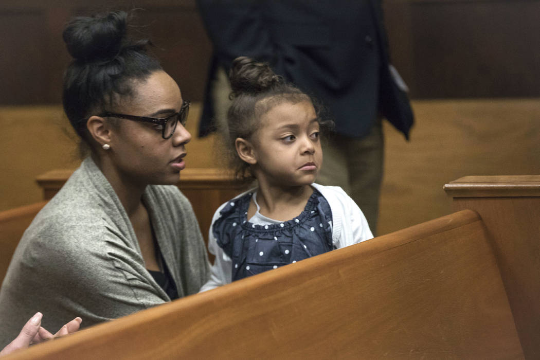 In this Wednesday, April 12, 2017, file photo, Shayanna Jenkins Hernandez, fiancee of former New England Patriots tight end Aaron Hernandez, sits in the courtroom with the couple's daughter during ...