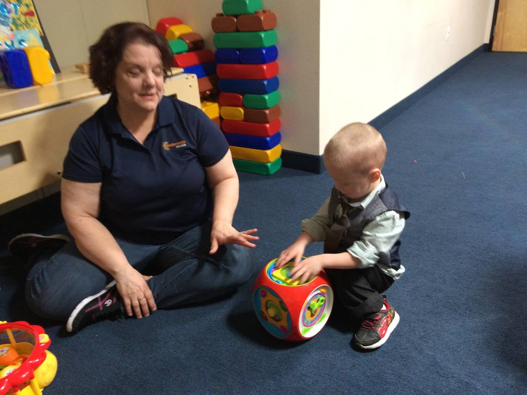 "Kim Duhon, //cq//developmental specialist, ""plays"" with Alexander Fellows May 10, 2017. At Easterseals, ""play' is really learning. Alexander spoke no more than 10 words when he came to the facilit ..."