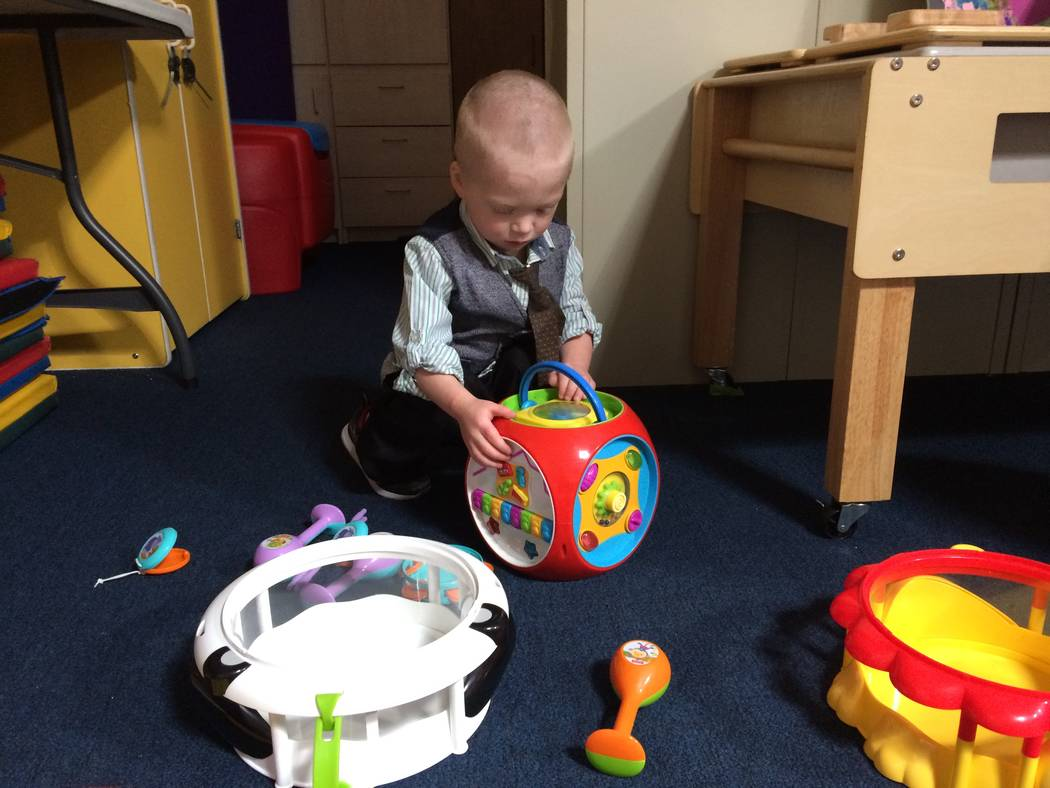 Alexander Fellows plays with toys at Easterseals new offices on West Charleston Boulevard. At age 2 1/2, he was speaking only 10 words. With programming at Eastereseals, he is now saying about 50. ...