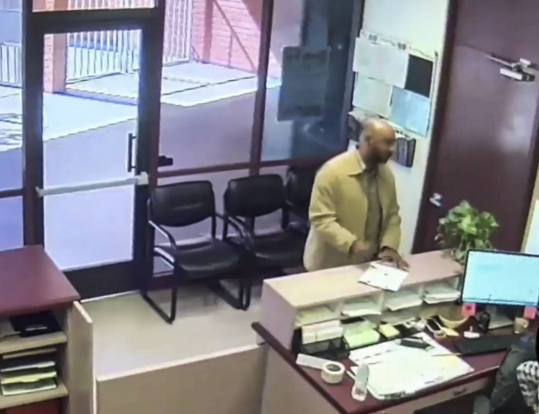 In this image made from surveillance video provided by the San Bernardino Police via the San Bernardino City Unified School District, Cedric Anderson walks into North Park Elementary before he ope ...