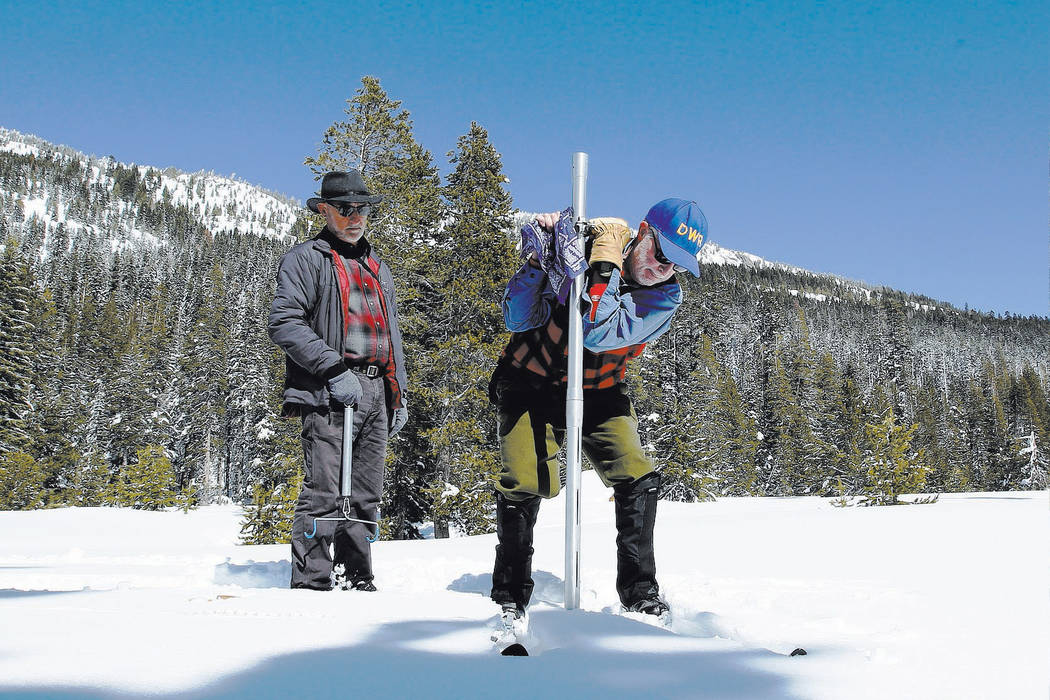 Frank Gehrke, right, chief of the California Cooperative Snow Surveys Program for the Department of Water Resources, conducts the third manual snow survey of the season at Phillips Station, Wednes ...