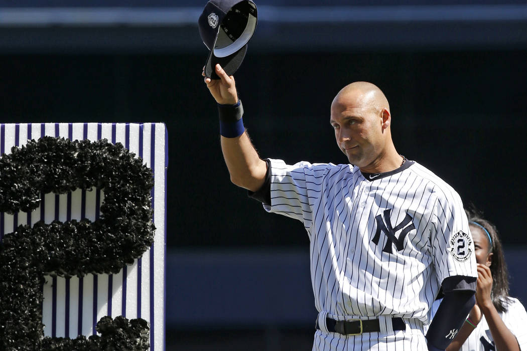 In this Sept. 7, 2014, file photo, New York Yankees' Derek Jeter (2) tips his cap to fans during a pregame ceremony honoring the Yankees captain. Jeter wrote an essay published May 11, 2017, on hi ...