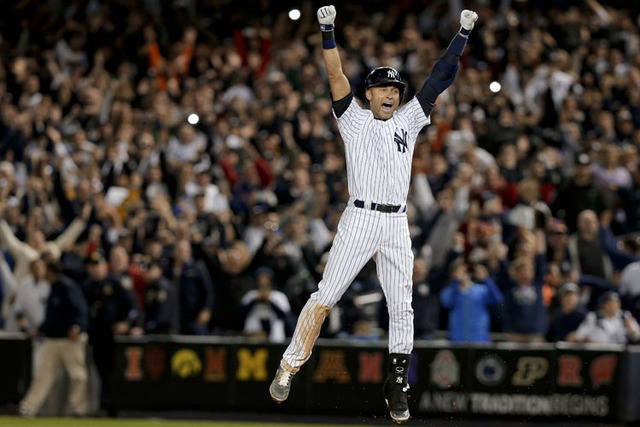 New York Yankees' Derek Jeter jumps after hitting the game-winning single against the Baltimore Orioles in the ninth inning of a baseball game, Thursday, Sept. 25, 2014, in New York. The Yankees w ...