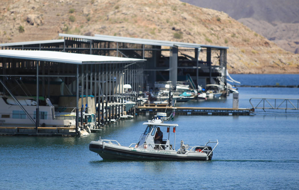 A National Park Service ranger drives a boat at the Lake Mead Marina near Las Vegas on Thursday, May 11, 2017. Brett Le Blanc Las Vegas Review-Journal @bleblancphoto