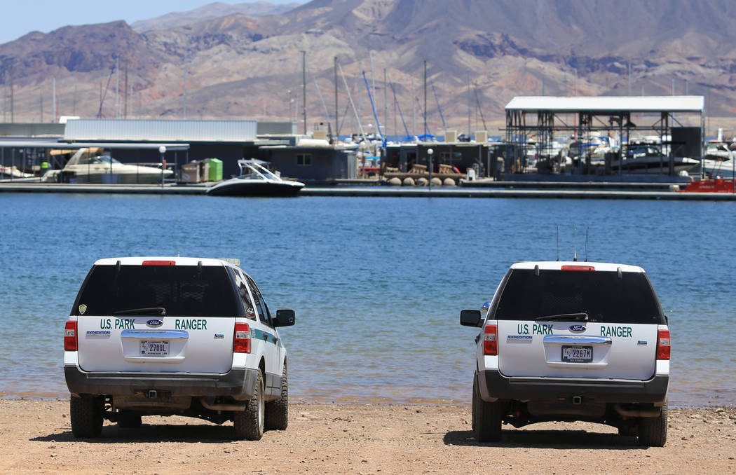 Two National Park Service ranger trucks sit parked at the waterfront of the Lake Mead Marina near Las Vegas on Thursday, May 11, 2017. Brett Le Blanc Las Vegas Review-Journal @bleblancphoto