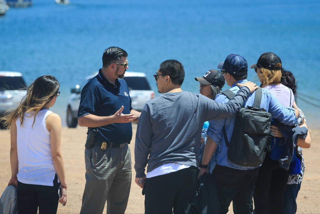 A National Park Service ranger talks to a group of people at Lake Mead Marina near Las Vegas on Thursday, May 11, 2017. Brett Le Blanc Las Vegas Review-Journal @bleblancphoto