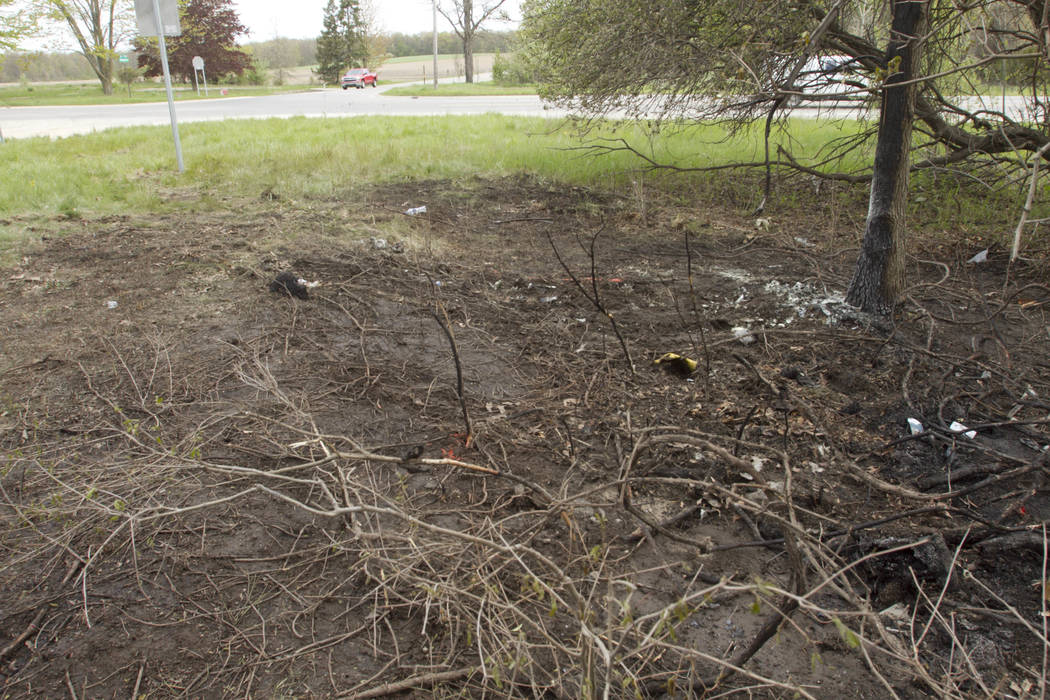 Debris is seen Wednesday, May 10, 2017, at the scene of a fatal crash that occurred Tuesday in Livingston County's Oceola Township, Mich. Investigators said a car driven by a young man from the Fe ...