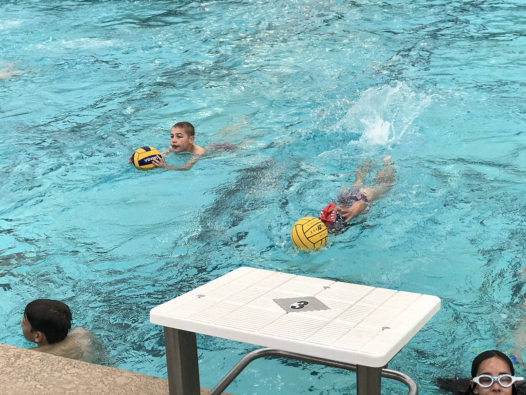 Members from Team Vegas Water Polo practice swimming drills May 9 at the Henderson Multigenerational Center. (Danny Webster/View)