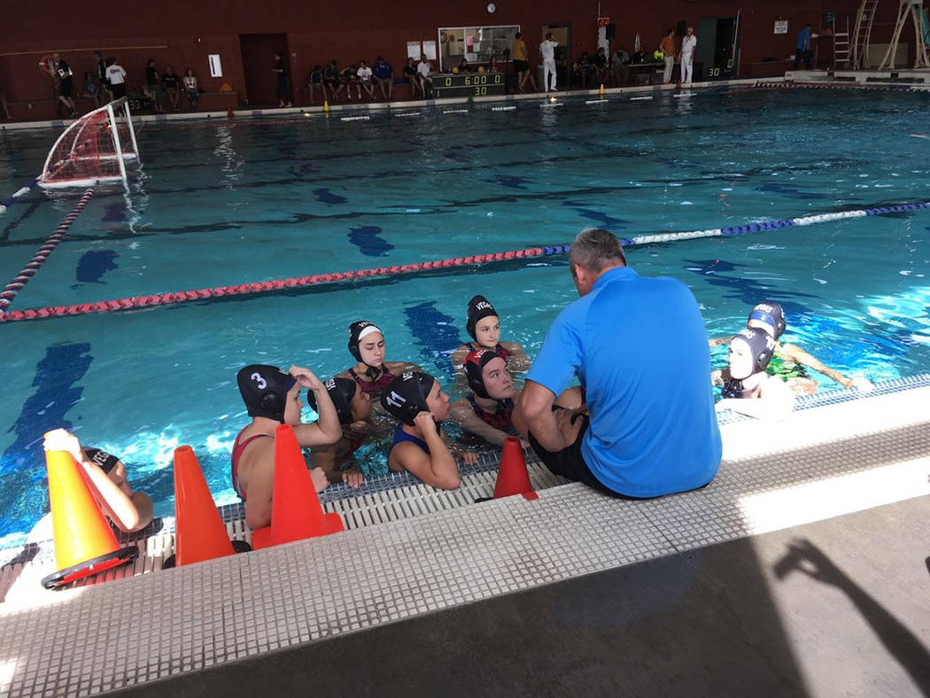 Assistant coach Chris Magee talks with his team of varsity girls during the Utah Summer Games at Southern Utah University. (Team Vegas Water Polo)