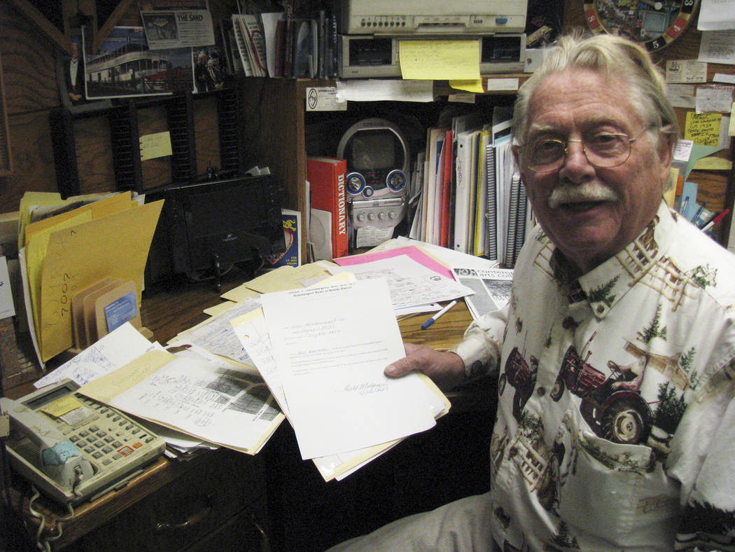 In the office of his home in the Paradise Crest neighborhood, Dr. Lonnie Hammargren holds a file of petitions signed by his neighbors regarding his attempt to hold more events there. 2009 photo. ( ...