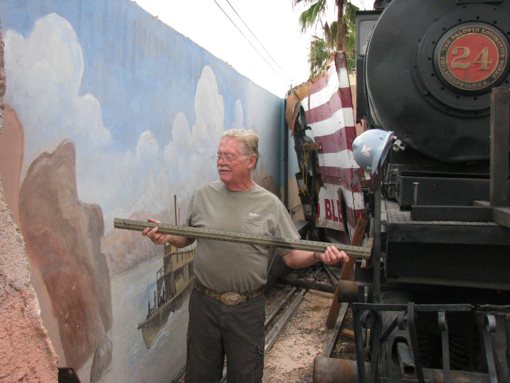 Lonnie Hammargren measuring the distance between the back wall and a locomotive at this unusual home, Castillo del Sol in Paradise Nevada, near the corner of Sandhill and Flamingo Road. In 2010 he ...