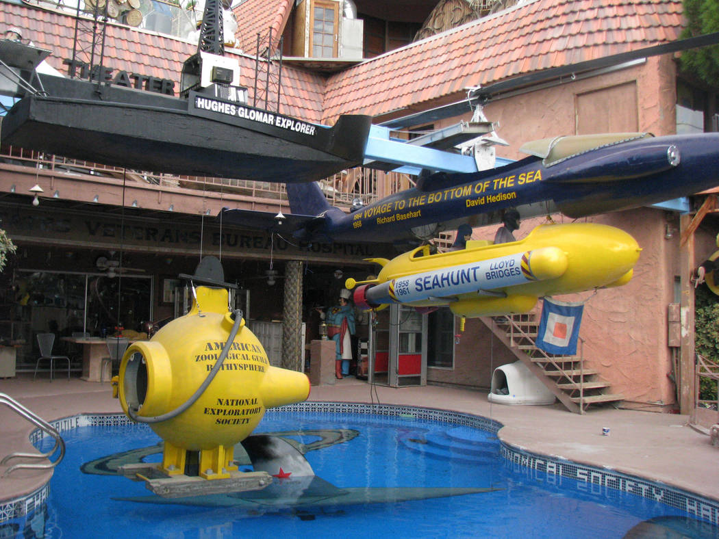 Lonnie Hammargren's home includes a model of the Hughes Glomar Explorer suspended over the swimming pool. The model submarines are among the items Hammargren is not sure he'll be able to fi ...