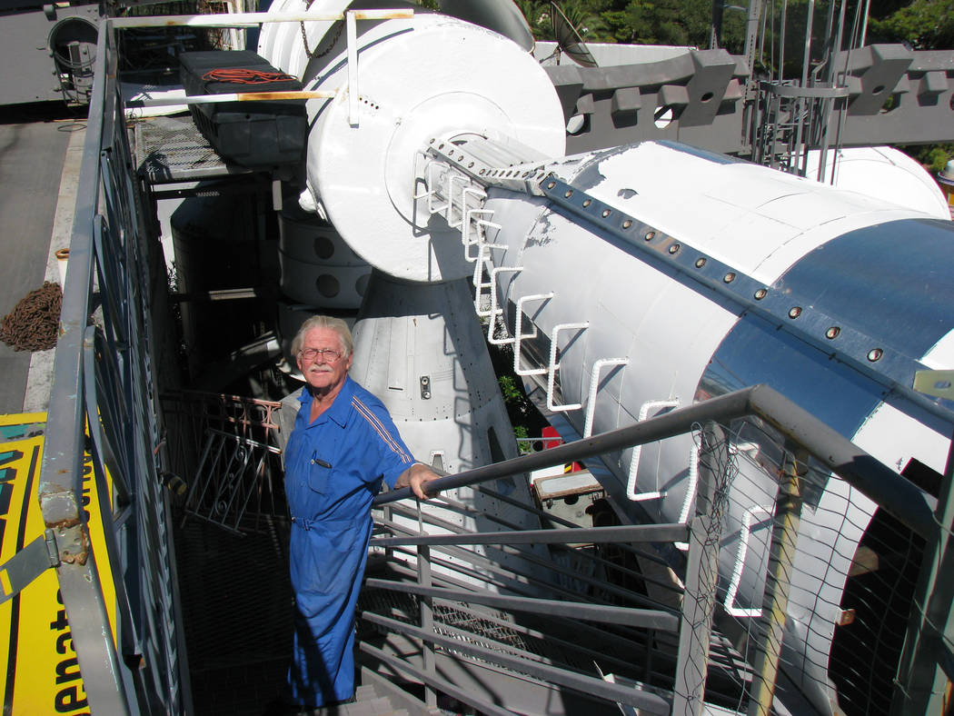 Dr. Lonnie Hammargren pauses on a staircase on a section of his roof that is dedicated to space exploration at his home on 4300 Ridgecrest Drive on October 11, 2011.   (F. Andrew Taylor/Review-Jou ...