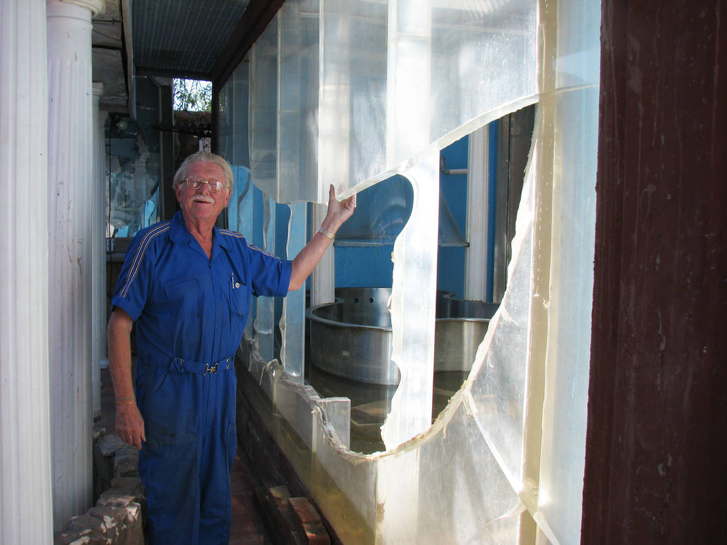 Dr. Lonnie Hammargren shows off the damage to the acrylic tank  at his home on 4318 Ridgecrest Drive. The tank had been a major part of the property for nearly 40 years until the tank burst during ...