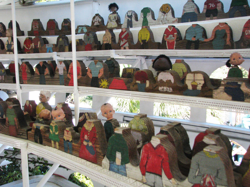 Hammargren's  complex is home to a many odd objects and collections, some of which like this decapitated wooden doll audience, are hard to explain. 2012 photo.  (F. Andrew Taylor/Review-Jou ...