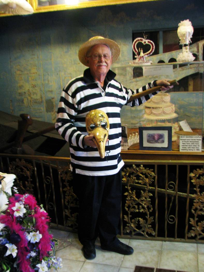 F. ANDREW TAYLOR/VIEW Among the unusual items in Lonnie Hammargren's complex of homes at 4318 Ridgecrest Drive is a Gondola that he believes may be the oldest in the world. Dr. Hammargren poses wi ...