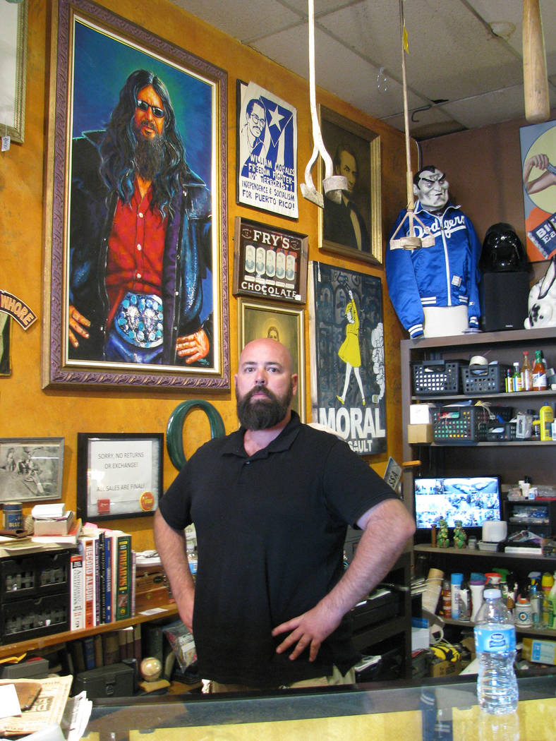 Jeff Young of Modern Mantiques, 1300 S. Main St. poses with a painting of Buffalo Jim Barrier that he acquired from Lonnie Hammargren's home. The retired neurosurgeon is losing one of the h ...