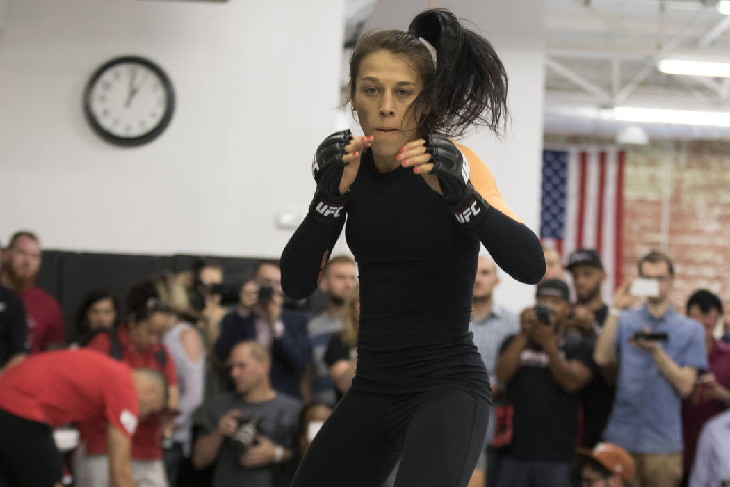 UFC women's strawweight champion Joanna Jedrzejczyk shadow boxes at the UFC 211 open workouts at the Mohler MMA gym in Dallas, Texas, on Thursday, May 11, 2017. Heidi Fang/Las Vegas Review-Journal ...