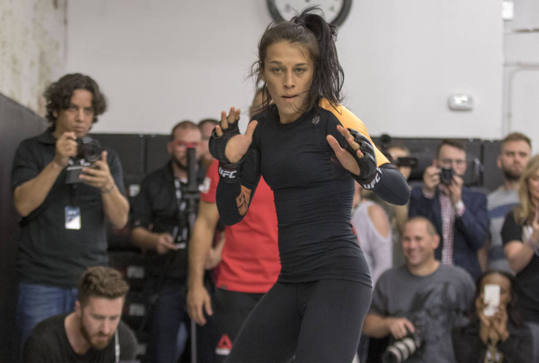 UFC women's strawweight champion Joanna Jedrzejczyk prepares to strike at the UFC 211 open workouts at the Mohler MMA gym in Dallas, Texas, on Thursday, May 11, 2017. Heidi Fang/Las Vegas Review-J ...