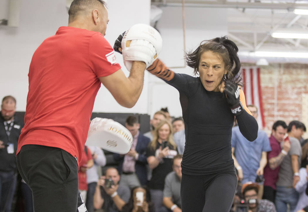 UFC women's strawweight champion Joanna Jedrzejczyk lands a punch during the UFC 211 open workouts at the Mohler MMA gym in Dallas, Texas, on Thursday, May 11, 2017. Heidi Fang/Las Vegas Review-Jo ...