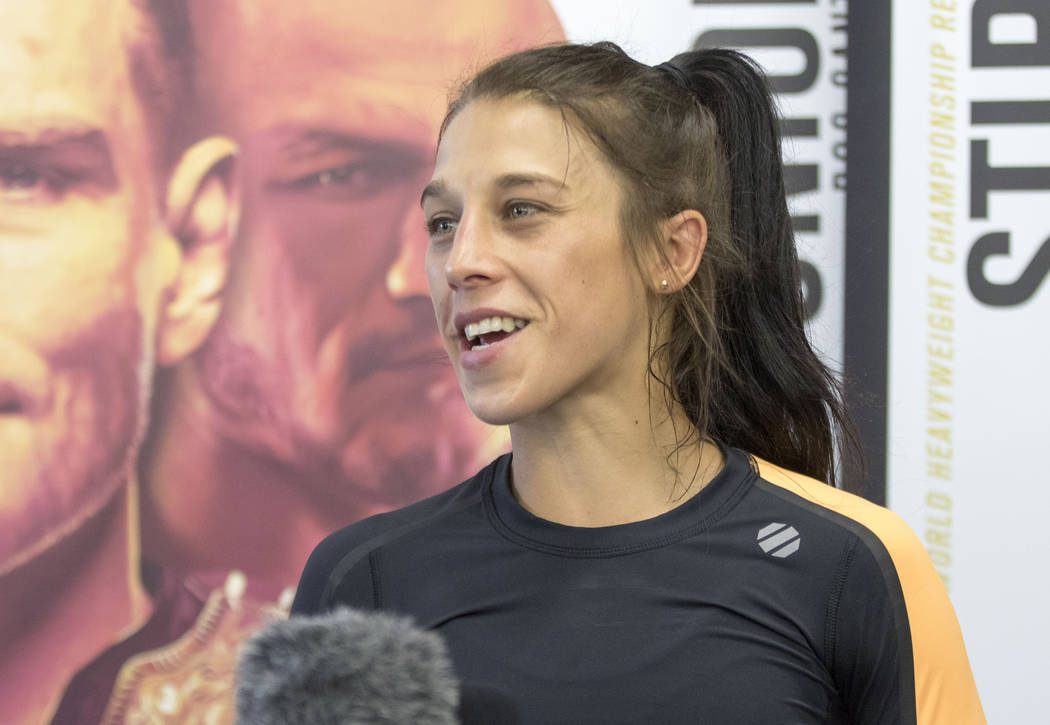 UFC women's strawweight champion Joanna Jedrzejczyk answers questions from reporters during the UFC 211 open workouts at the Mohler MMA gym in Dallas, Texas, on Thursday, May 11, 2017. Heidi Fang/ ...