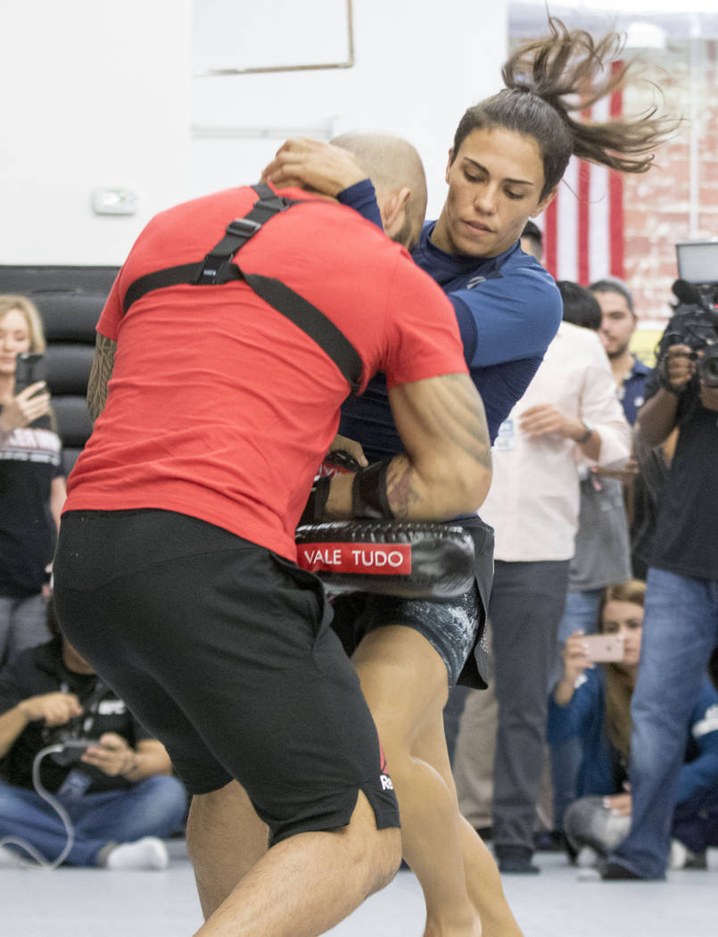 UFC strawweight Jessica Andrade throws a knee in the clinch at UFC 211 open workouts at the Mohler MMA gym in Dallas, Texas, on Thursday, May 11, 2017. Heidi Fang/Las Vegas Review-Journal @HeidiFang