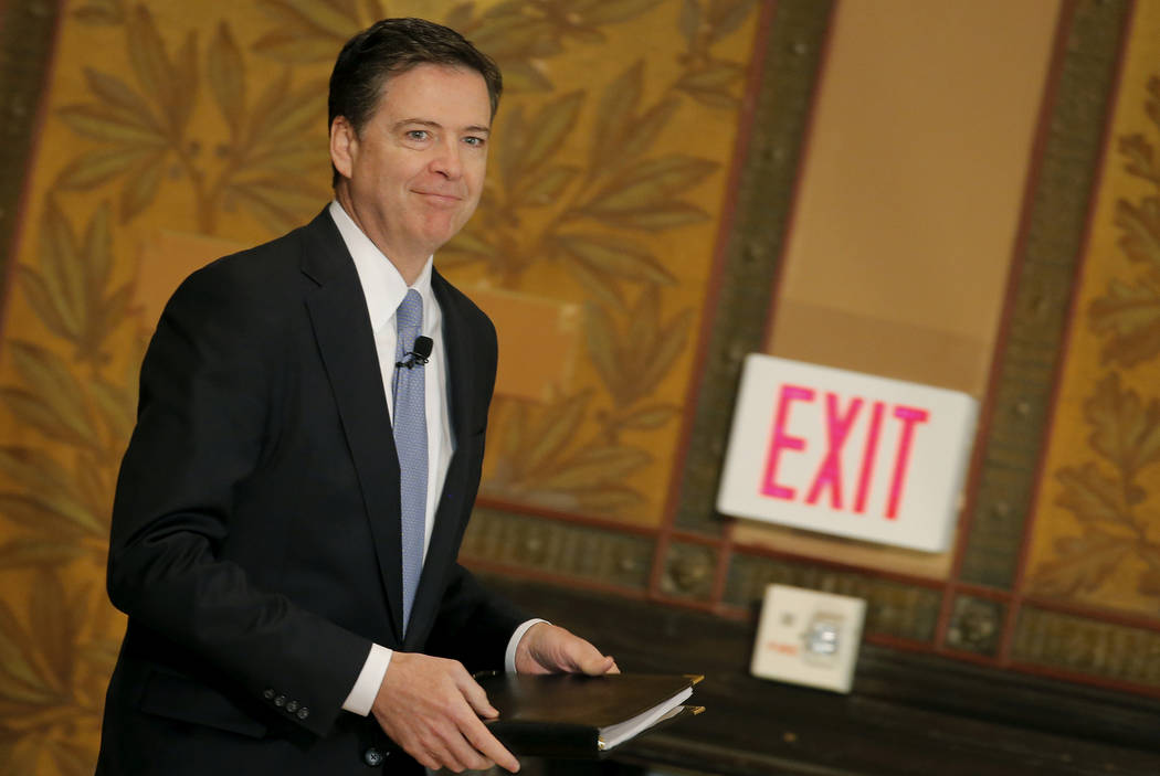FBI Director James Comey arrives to deliver a speech at the Master of Science in Foreign Service CyberProject's sixth annual conference at Georgetown University in Washington D.C., U.S. on April 2 ...