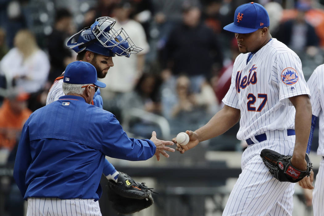 New York Mets relief pitcher Jeurys Familia (27) hands the ball to manager Terry Collins, left, as catcher Kevin Plawecki looks as Familia leaves in the ninth inning of a baseball game against the ...