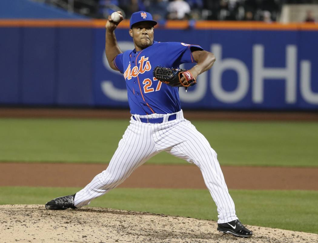 New York Mets relief pitcher Jeurys Familia (27) delivers during the eleventh inning of a baseball game against the Washington Nationals Friday, April 21, 2017, in New York. (AP Photo/Frank Frankl ...