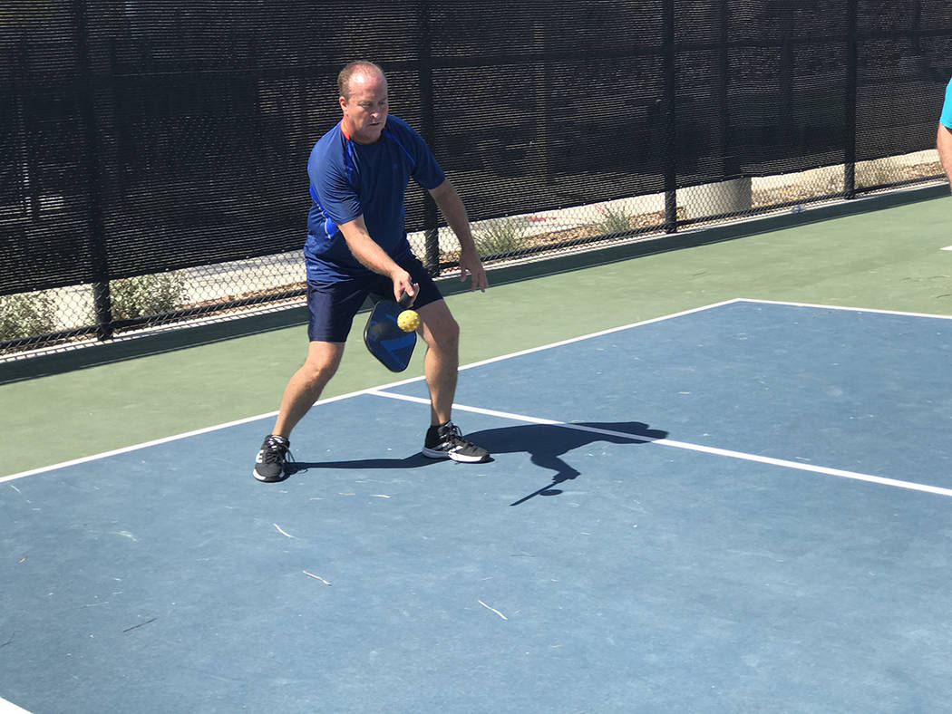 Henderson resident Dean Price returns a serve during a game of pickleball May 9 at Whitney Mesa Recreation Area, 1661 Galleria Drive. (Danny Webster/View)