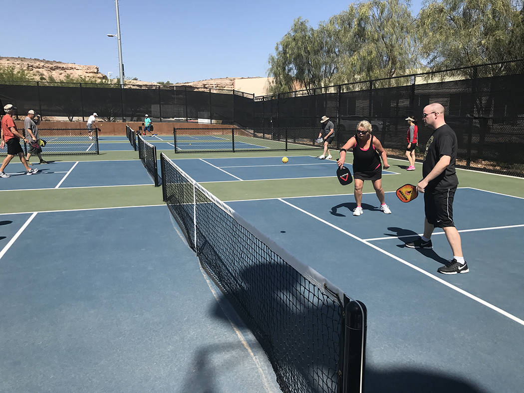 Debbie Kirk returns a serve as her son Ryan watches on at Whitney Mesa Recreation Area. These are the first courts dedicated to pickleball in Henderson. (Danny Webster/View)