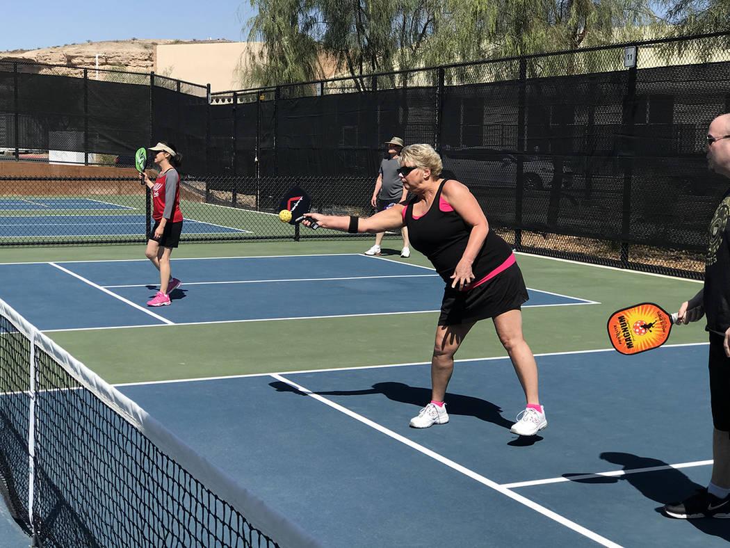 Debbie Kirk returns a serve during a game of pickleball. (Danny Webster/View)