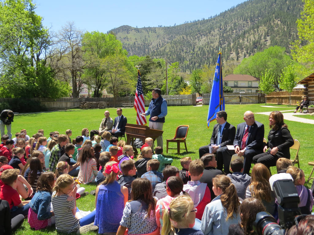 "Gov. Brian Sandoval talks with school children before signing Assembly Bill 385 at a ceremony in Genoa on Friday, May 12, 2017. The ""Kids in Parks"" law gives every Nevada fifth-grader, and anyone  ..."