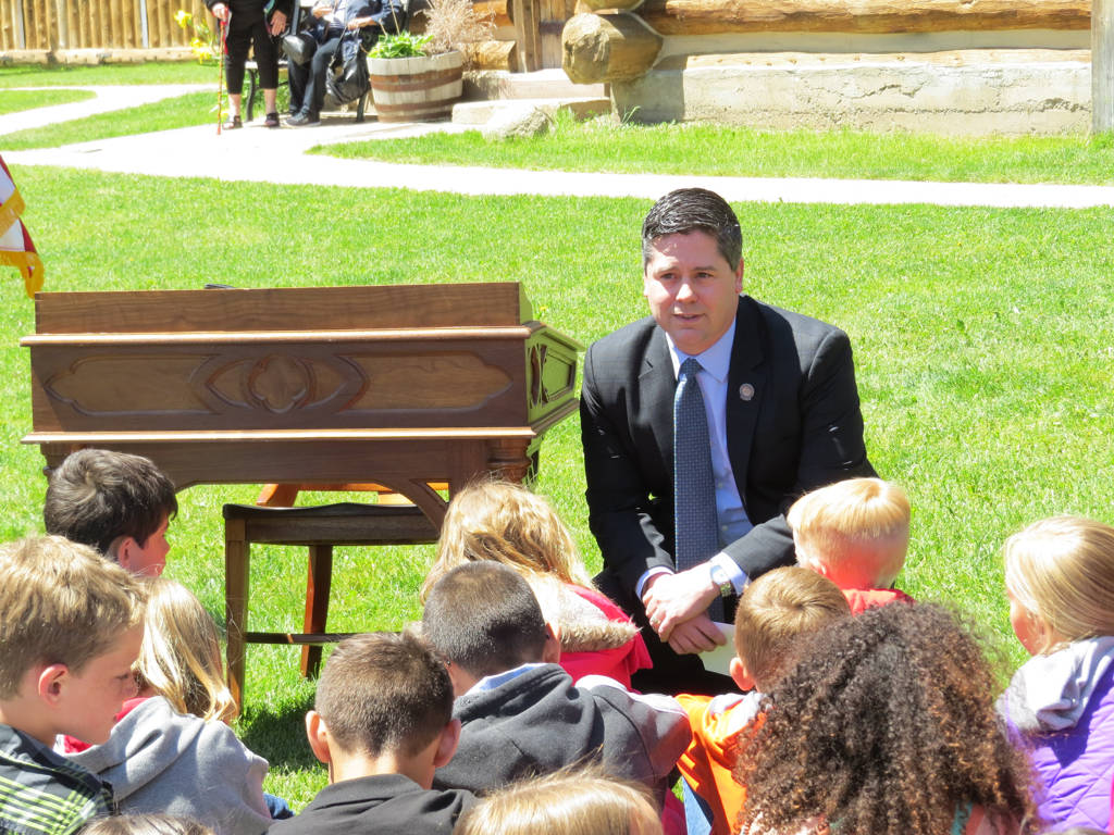"Assemblyman Steve Yeager, D-Las Vegas, talks with school children at a bill signing ceremony in Genoa on Friday, May 12, 2017. Yeager sponsored Assembly Bill 385, the ""Kids in Parks"" law, that giv ..."